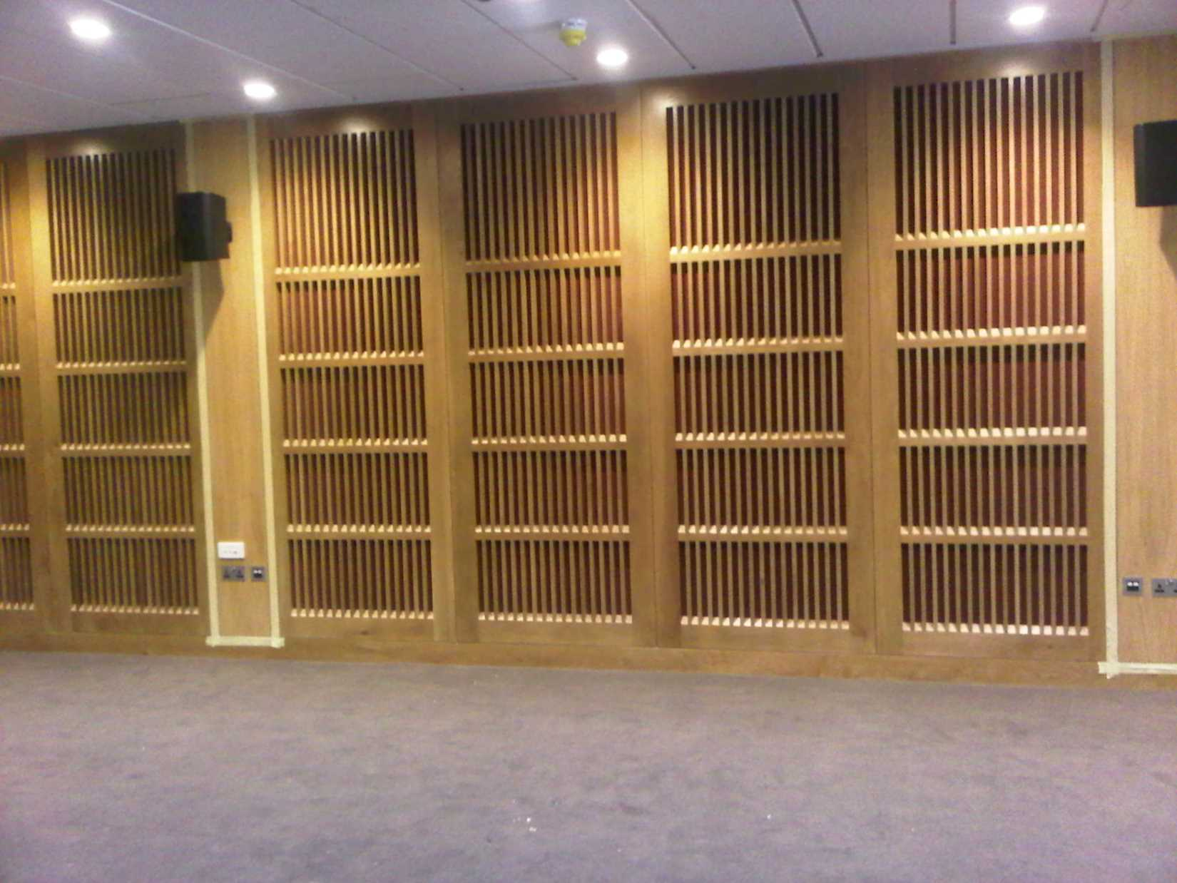 Sound absorbent timber panels
